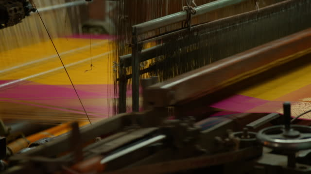 sequence showing power looms at work in uttar pradesh, india. - loom stock videos & royalty-free footage