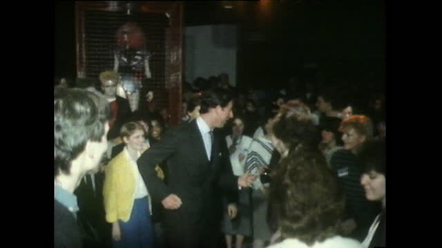 sequence showing prince charles dancing on a dance floor and talking to the public while visiting a project in bristol; 1985. - nostalgia stock videos & royalty-free footage