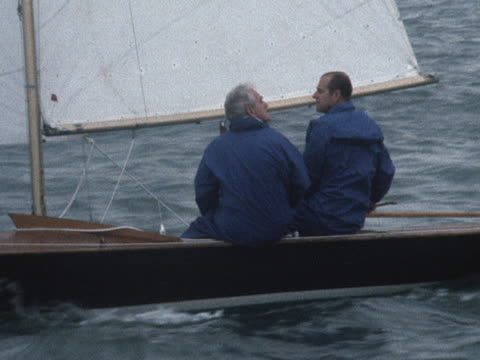 vidéos et rushes de sequence showing prince philip and uffa fox taking part in a sailing race during cowes week - cowes