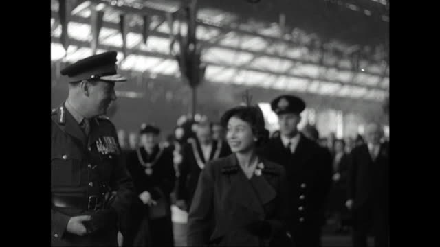 Sequence showing Princess Elizabeth and the Duke of Edinburgh greeting various dignitaries before boarding a train at Liverpool's Lime Street station
