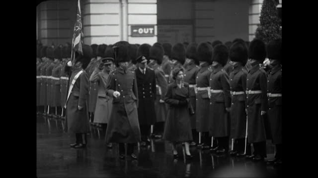 Sequence showing Princess Elizabeth inspecting a line of troops at London's Euston Station