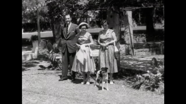 stockvideo's en b-roll-footage met sequence showing princess margaret with the governor of barbados and his wife as they walk through the gardens of his official residence - koninklijk persoon