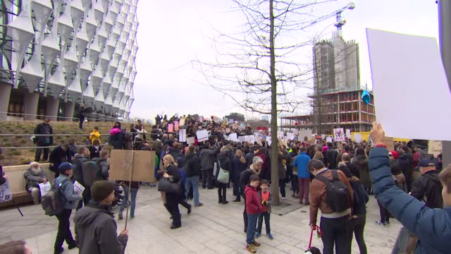 sequence showing protestors at the 'march for our lives' anti gun rally outside the us embassy in london uk - march for our lives stock videos and b-roll footage