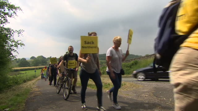 Sequence showing protestors in Windermere protesting Northern Rail