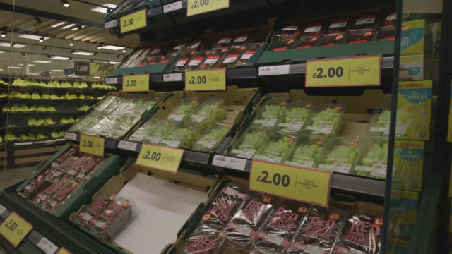sequence showing punnets of grapes on tesco supermarket shelves, uk. - price tag stock videos & royalty-free footage