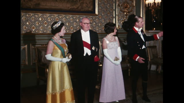 sequence showing queen elizabeth and prince phillip holding a royal banquet for the italian president giuseppe saragat at windsor castle - queen royal person stock videos & royalty-free footage