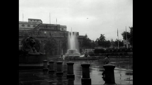 sequence showing quiet trafalgar square on rainy day;1951 - 1951 stock videos & royalty-free footage