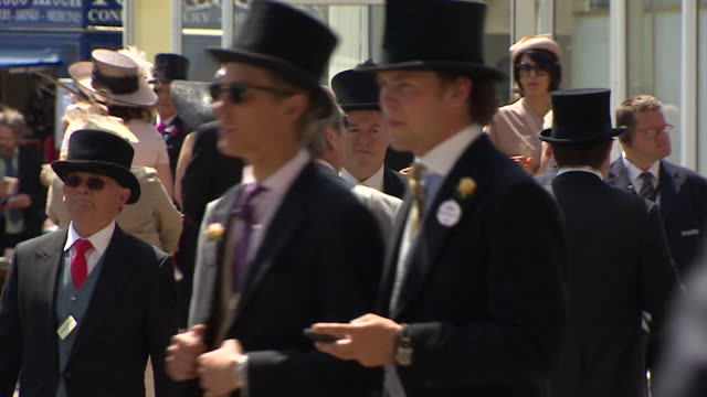 sequence showing race goers in formal wear at ascot racecourse - berkshire england stock videos & royalty-free footage
