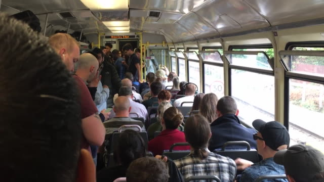 vidéos et rushes de sequence showing rail commuters in a busy train carriage in greater manchester - wagon