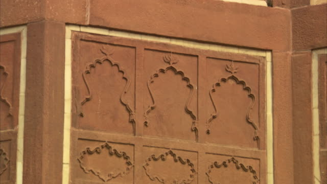 Sequence showing reliefs on an exterior wall at Agra Fort, India.