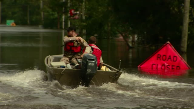 Sequence showing rescue boats in a flooded Pollocksville North Carolina in the aftermath of Hurricane Florence