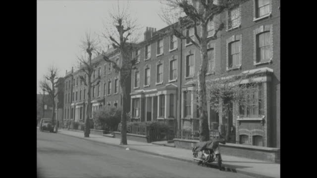 sequence showing residential streets in suburban london - bbc archive stock-videos und b-roll-filmmaterial