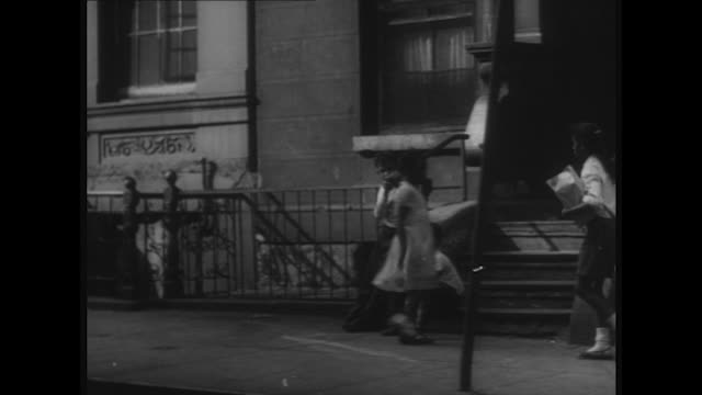 sequence showing residents of the east side harlem and chinatown going about their daily lives - harlem stock videos & royalty-free footage