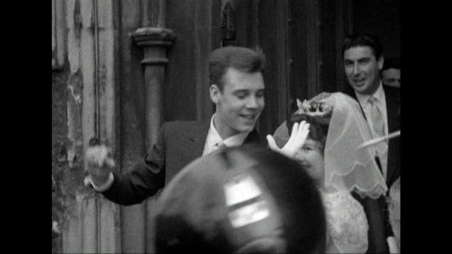 Sequence showing rock and roll star Marty Wilde leaving a church with his new bride