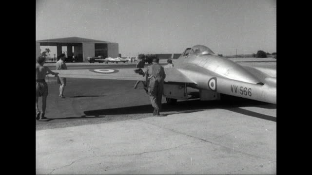 Sequence showing royal air force technicians prepping a Vampire fighter aircraft for takeoff at a base in the Suez Canal zone