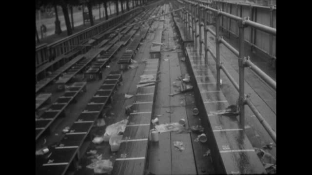 sequence showing rubbish littering stands that were erected for the queen's coronation in the mall - coronation stock videos and b-roll footage