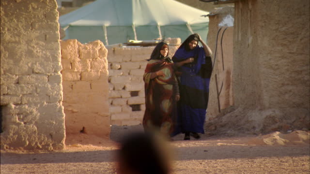 Sequence showing Sahrawi people going about their daily lives at a refugee camp in Tindouf province, Algeria.