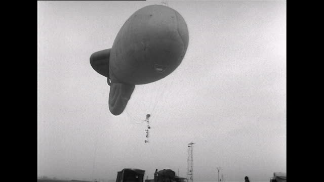 sequence showing scientists releasing a modified barrage balloon to conduct experiments into fog. - meteorology stock videos & royalty-free footage