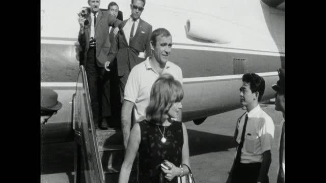 sequence showing sean connery getting off a passenger plane at a japanese airport with his wife, diane cilento. he stops to wave. medium shot... - east asian ethnicity stock videos & royalty-free footage