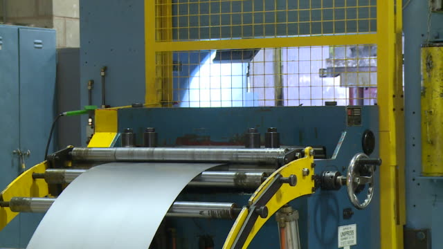 sequence showing sheets of metal being cut into shape on an automated factory production line - metal clip stock videos and b-roll footage