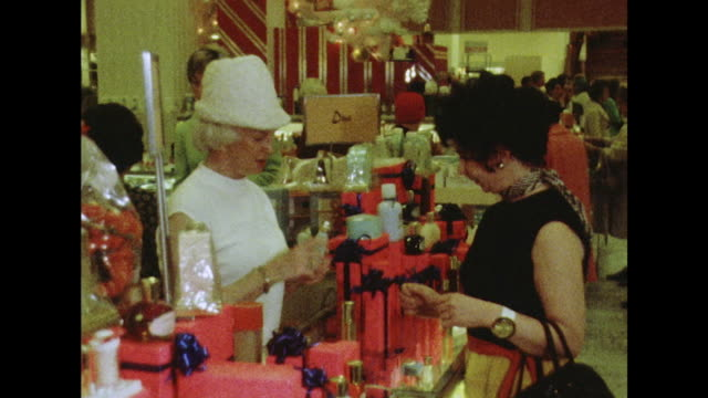 sequence showing shoppers and staff members in a busy department store in san francisco. - cosmetics stock videos & royalty-free footage