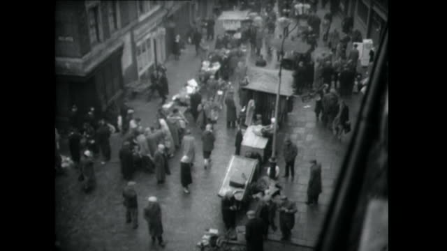 Sequence showing shoppers browsing the goods on display at Petticoat Lane Market London