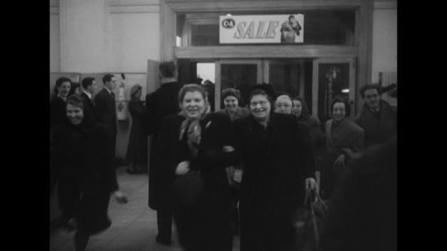 Sequence showing shoppers running into the CA department store on London's Oxford Street at the start of the January sales