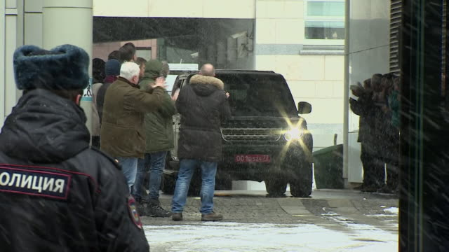 sequence showing shots of british diplomats leaving the british embassy in moscow after their expulsion - botschafter stock-videos und b-roll-filmmaterial