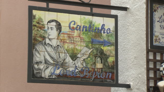Sequence showing signs depicting the poet Lord Byron at a bar in Sintra Portugal FKIY886P ABRA690X
