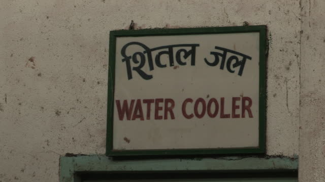 Sequence showing signs for a water cooler and tool room in a railway maintenance workshop in Mumbai Maharashtra India FKAD675A Clip taken from...