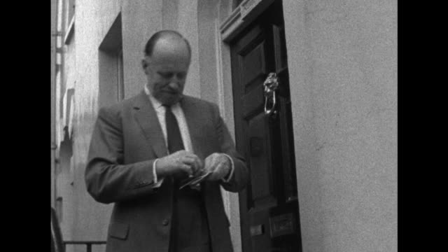 sequence showing sir basil spence president of the royal institute of british architects opening a telegram - telegram stock videos & royalty-free footage