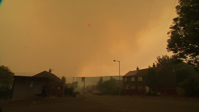 sequence showing smoke filled skies in greater manchester following the fire at saddleworth moor - orange colour stock videos & royalty-free footage