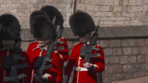 sequence showing soldiers marching outside windsor castle, uk. - guarding stock videos & royalty-free footage