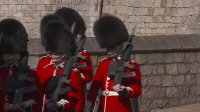 sequence showing soldiers marching outside windsor castle uk fkau104l clip taken from programme rushes aezq152y - honour guard stock videos & royalty-free footage