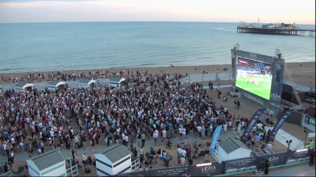 sequence showing spectators watching columbia score a goal in their world cup match against england on brighton beach - projection screen stock videos & royalty-free footage