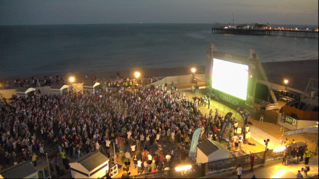 sequence showing spectators watching england win their world cup match against columbia on penalties on brighton beach - brighton england stock videos & royalty-free footage