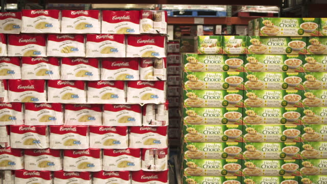 sequence showing stacked longlife food at a costco wholesale warehouse usa fkax253n clip taken from programme rushes ablb597x - tin can stock videos & royalty-free footage