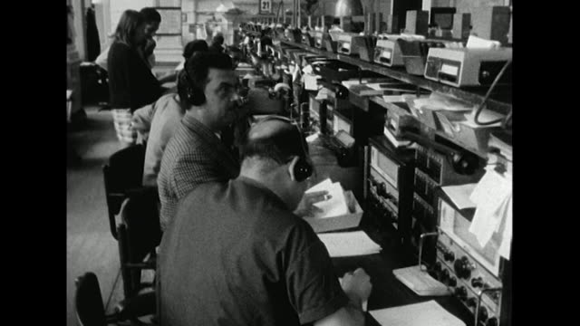 Sequence showing staff at the BBC's monitoring service listening to radio broadcasts from Czechoslovakia on the current Russian invasion