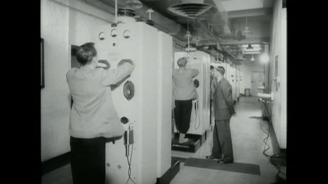 sequence showing staff at the windscale plutonium factory finishing a shift and using geiger counters to check for any trace radiation on their bodies - laboratory equipment stock videos & royalty-free footage