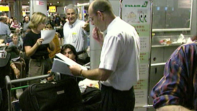 sequence showing staff members inside heathrow airport help stranded passengers as america re-opens its airspace after the 9/11 attacks and hundreds... - suitcase stock videos & royalty-free footage