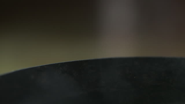 sequence showing steam rising from the edge of a bowl of soup. - dampf stock-videos und b-roll-filmmaterial