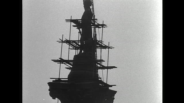 sequence showing steeplejacks cleaning nelson's column in preparation for the coronation of queen elizabeth ii - coronation stock videos and b-roll footage