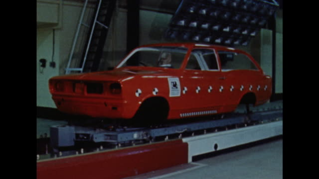 sequence showing technicians at the vauxhall factory preparing a car for a crash test simulator. - crash test stock videos & royalty-free footage