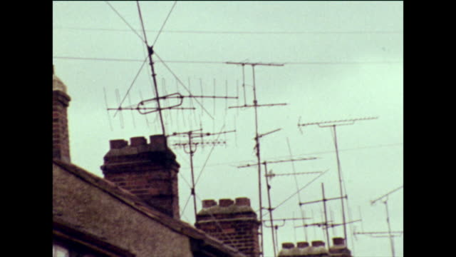 sequence showing television aerials on rooftops; 1973 - overcast stock videos & royalty-free footage