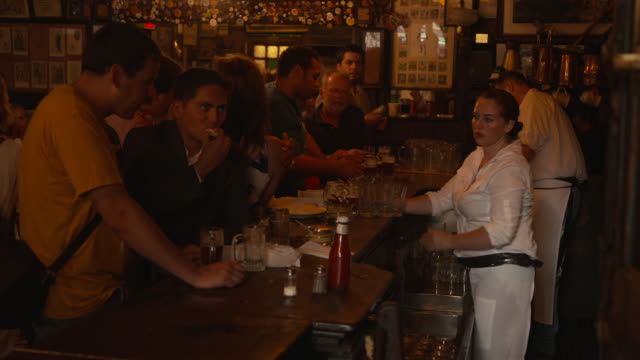 Sequence showing Teresa Maher de la Haba working behind the bar of McSorley's Old Ale House in Manhattan New York City USA FKAX252T Clip taken from...