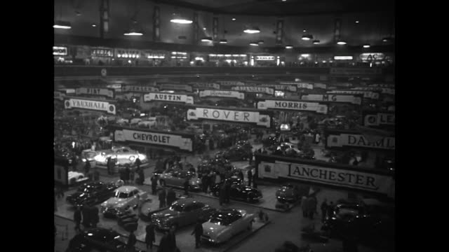 sequence showing the 37th motor show at london's earl court - motor show stock videos and b-roll footage