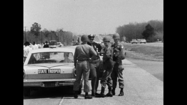 vídeos de stock, filmes e b-roll de sequence showing the alabama national guard moving in to protect the selma marchers on their route from selma to montgomery; 24th march 1965.las up... - 1965