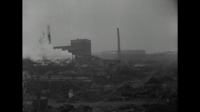 sequence showing the bomb damaged krupp factories and steelworks in essen - metal industry stock videos & royalty-free footage