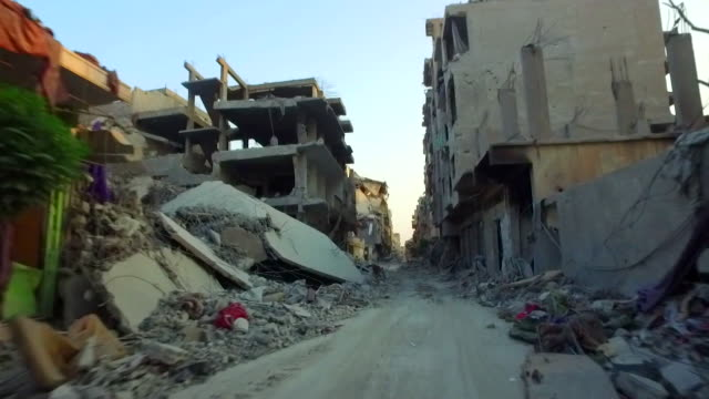 sequence showing the bombedout remains of the streets of raqqa amid continuing conflict syria september 2017 nnbz127d absa627d - syrien stock-videos und b-roll-filmmaterial