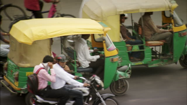 sequence showing the busy city of ahmedabad, india. - rickshaw stock videos and b-roll footage